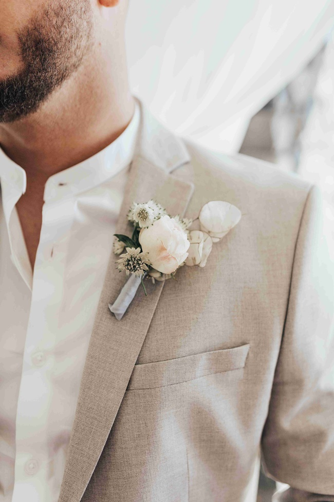 Groom's boutonniere in Santorini