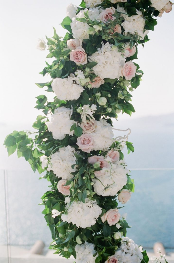 Ceremony arch with roses at Cavo Ventus wedding