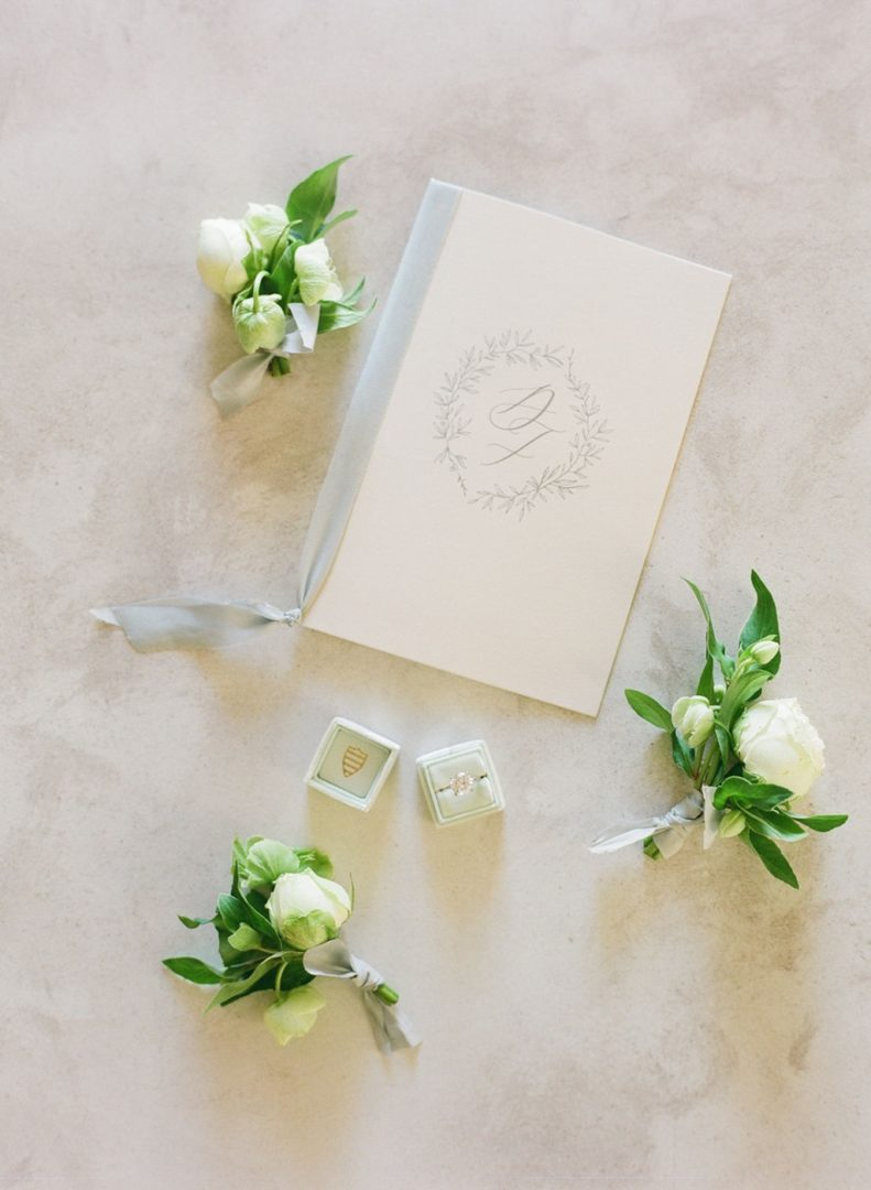 White roses boutonnieres by Redboxdays.gr